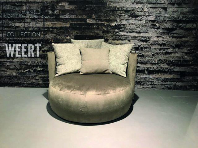 Fauteuil Budel in taupe, beige fluweel zachte microleder stof. Ruime comfortabele hocker fauteuil zonder arm in grote uitvoering vooraanzicht