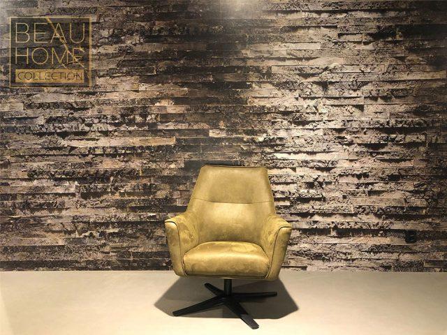 Voor-aanzicht-leren-groene-fauteuil-met-een-zwarten-ijzeren-draaipoot